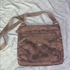 Goldish bronze coach bag with C monogram
